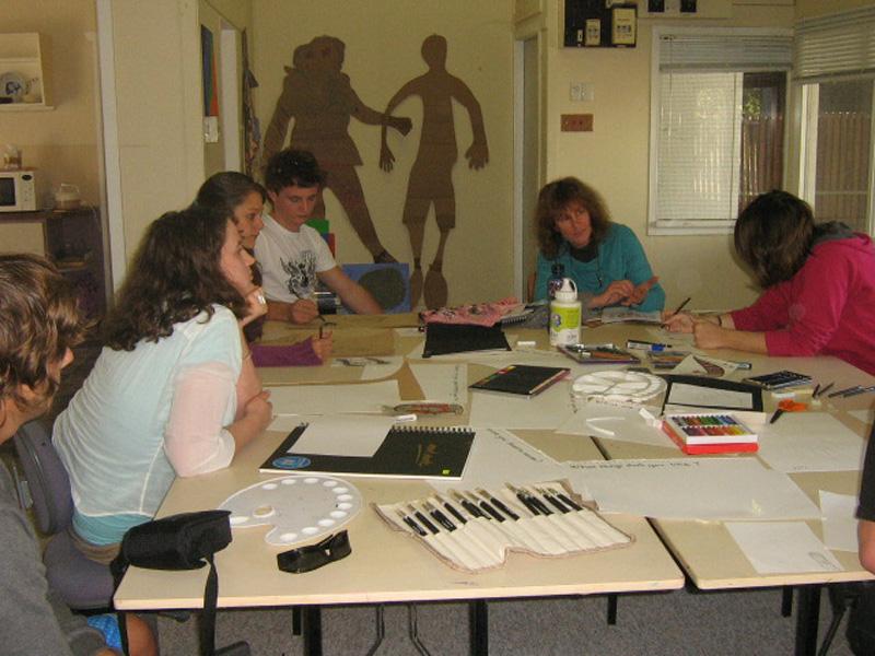 Barb Suttie teaching at painting workshop.